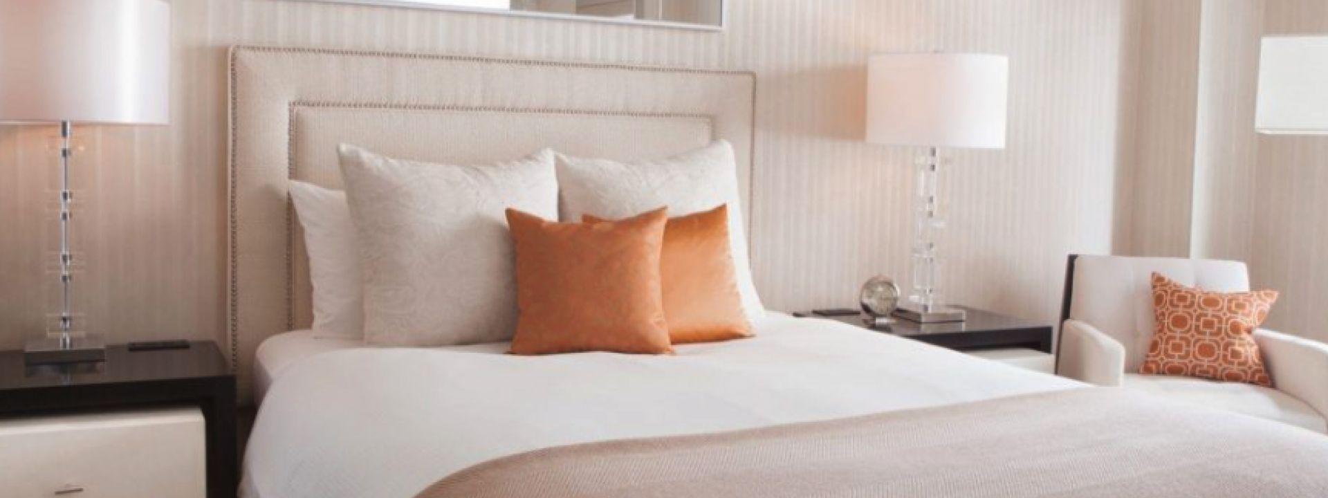 Queen bed at The Benjamin