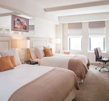 A double queen guest room at The Benjamin