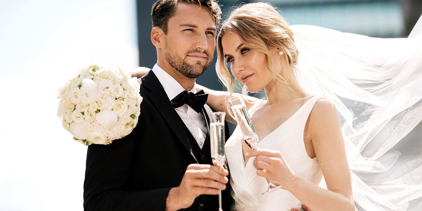 A Bride and Groom with champagne getting married at The Benjamin Hotel in NYC