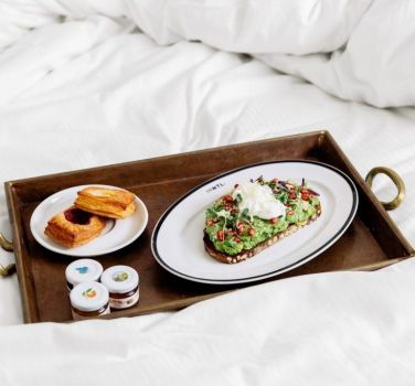 Tray of food on a bed