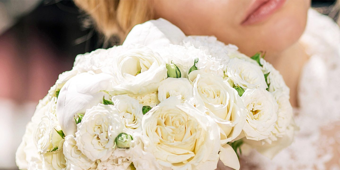 A Bride with wedding flowers at The Benjamin Hotel in NYC