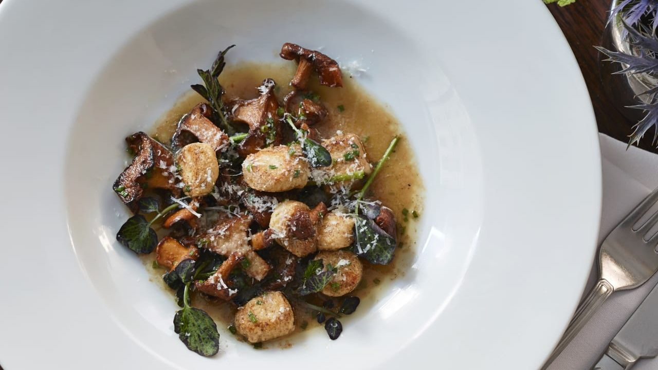 Sauteed mushrooms, scallops and greens from The Benjamin Hotel in NYC