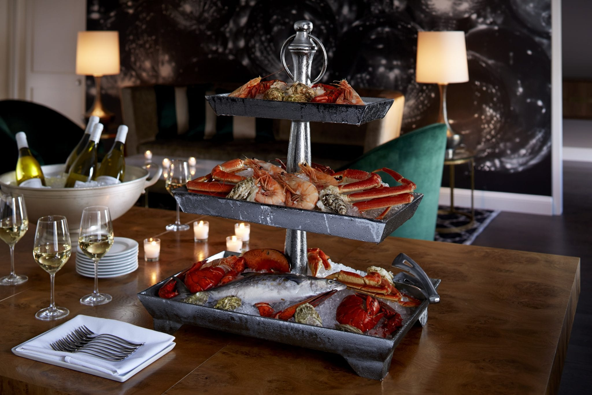 An in-room dining seafood platter with white wine at The Benjamin Hotel in NYC