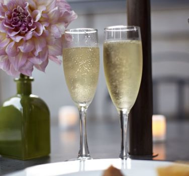 Two champagne flutes from The Benjamin Hotel in NYC