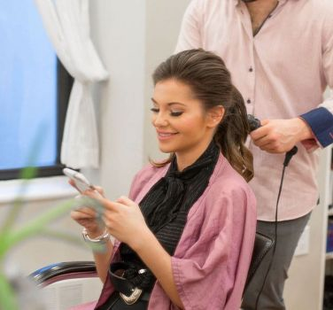 A woman getting her hair styled