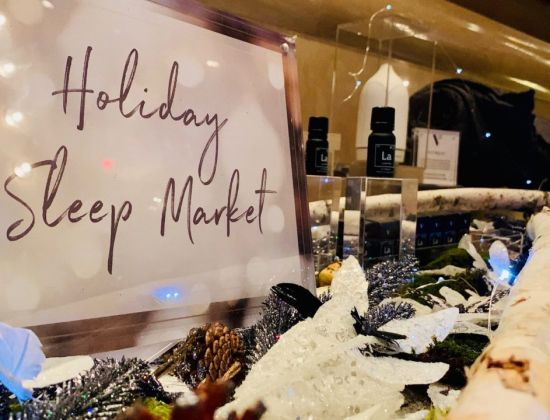 A Holiday Sleep Market sign and display in the lobby of The Benjamin Hotel in New York