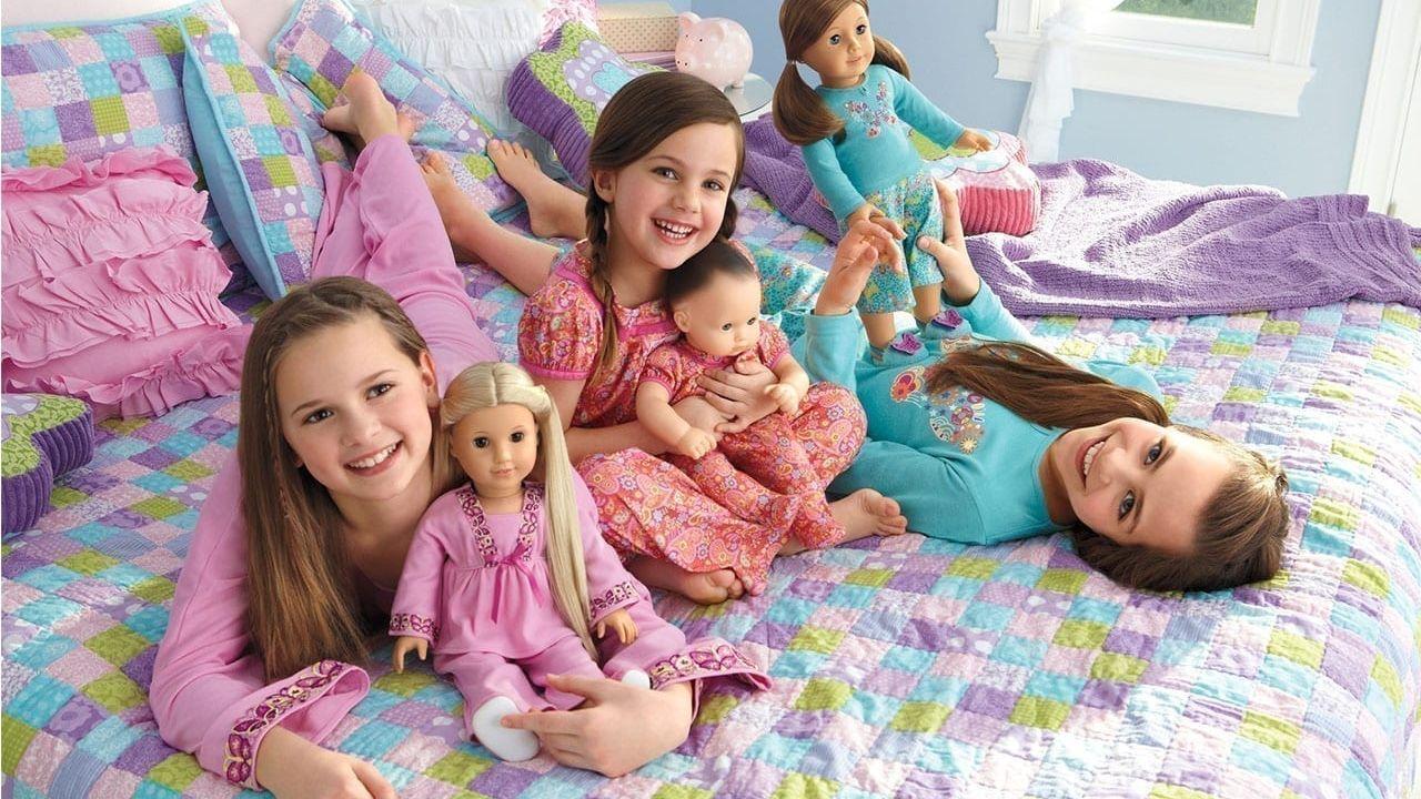 Three girls with American Girl Dolls