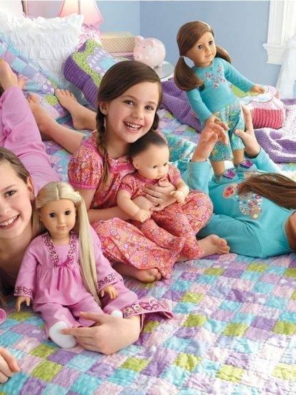 Three girls with American Girl Dolls