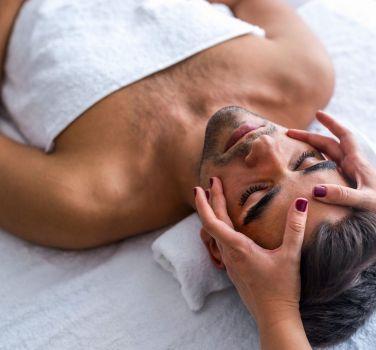A man getting a face massage