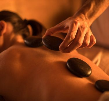 A woman getting hot stone therapy
