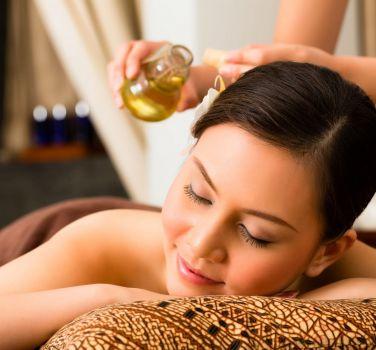 A woman getting an oil massage
