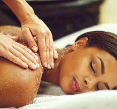 A woman getting a salt massage and halotherapy